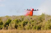 stock photo of retarded  - This P3 Orion drops retardant on a brush fire at the California - JPG