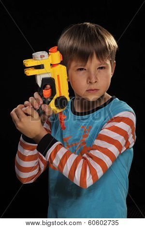 A boy with a toy gun.