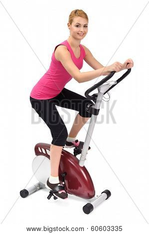 young woman doing indoor biking exercise, on white background