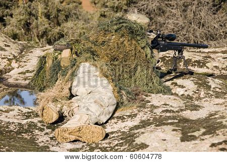Sniper Ghillie Dressed Pointing With Sniper Rifle L96-a1 - 1