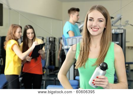Young womans engaged in simulator in gym