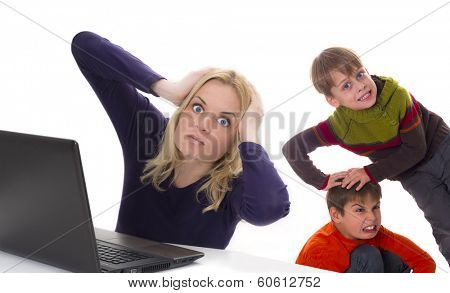 frustrated working mother with fighting kids