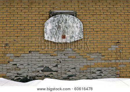 Hoop ripped off basketball backboard