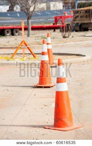 orange warning cones at construction site