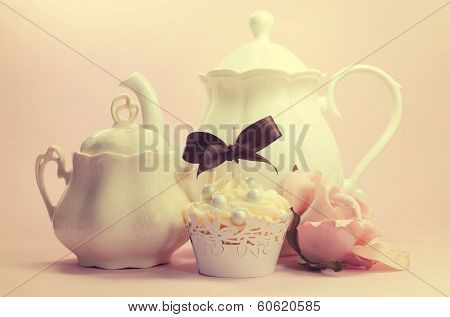 Retro vintage style tea setting with cupcake