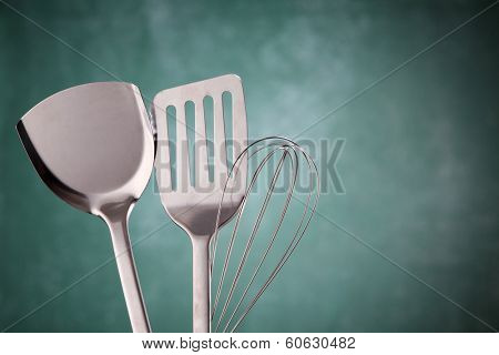 kitchen utensil in front of the chalkboard