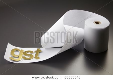 GST alphabet on the adding machine tape
