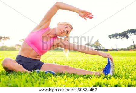 Athletic woman stretching before workout