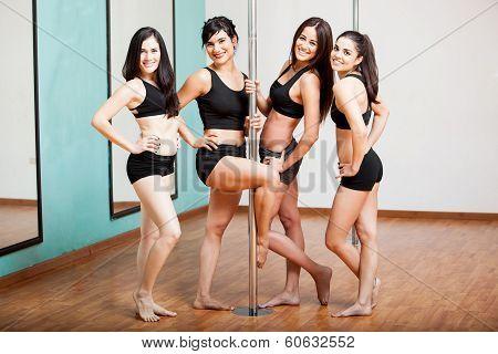 Group of pole dancers having fun