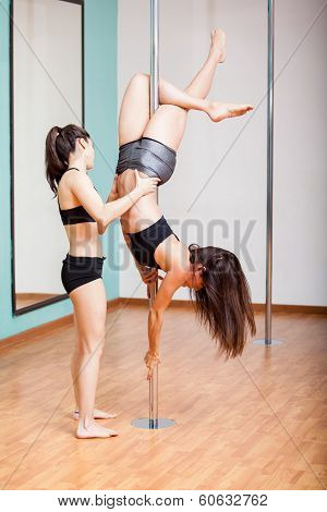 Pole dancing student and instructor