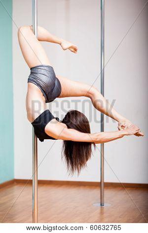 Beautiful woman pole dancing