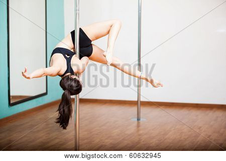 Pole fitness student working out