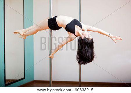 Reverse superwoman in a pole