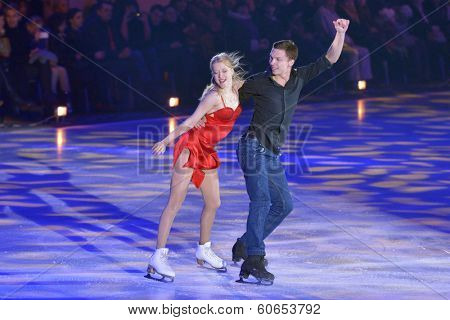 MOSCOW, RUSSIA - FEBRUARY 24, 2014: Ekaterina Bobrova and Dmitri Soloviev in action during Gala concert of Olympic champions in figure skating in Luzhniki