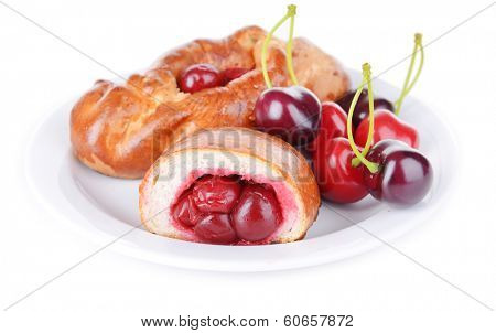 Fresh baked pasties with cherry isolated on white