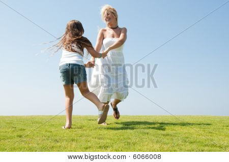 Young Mother Playing With Daughter