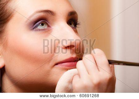 Makeup Artist Applying With Brush Lipstick On Lips Of Woman