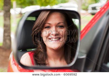 Female Portrait In Vehicle Mirror