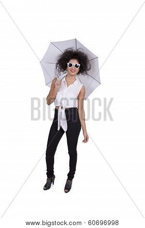 Young woman posing with umbrella and sunglasses