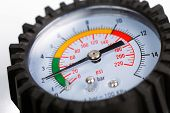 pic of vacuum pump  - A compressor pressure gauge on a white background