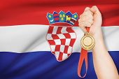 Medal In Hand With Flag On Background - Republic Of Croatia