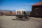 stock photo of covered wagon  - An old covered wagon on display in the southwest - JPG