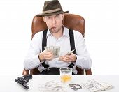foto of brass knuckles  - gangster sitting at a table counting money - JPG