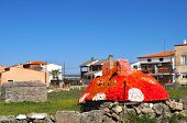 stock photo of guadalupe  - strange unusual shed looks like fly agaric with the red roof with white spots in a small town near Guadalupe Spain - JPG