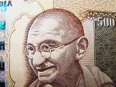 stock photo of indian money  - Mahatma Gandhi known as Father of India Nation on Indian Rupee Currency - JPG
