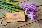 stock photo of purple iris  - Bouquet of flowers Irises and the card with the inscription Happy Mothers Day - JPG