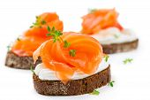 stock photo of canapes  - Canapes with salmon isolated on white background - JPG