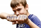 foto of pompous  - A boy stands in a fighting pose with the words  - JPG