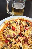 stock photo of sate  - very tasty pizza with glass of fresh beer - JPG