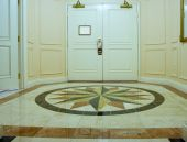 stock photo of anteroom  - Anteroom with wite double door and mosaic marble floor - JPG