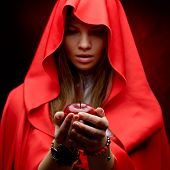 foto of cloak  - beautiful woman with red cloak holding apple - JPG