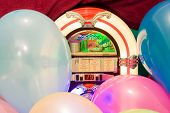 stock photo of jukebox  - Background of a jukebox and colorful baloons closeup - JPG