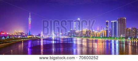 Guangzhou, China city skyline panorama over the Pearl River.