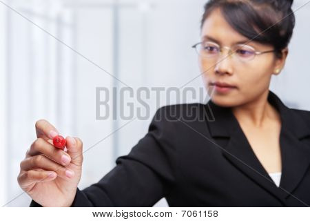 Asian Businesswoman Writing On Glass Board.
