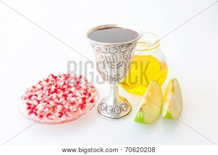 Rosh hashana Kiddush cup honey pomegranate and sliced apple