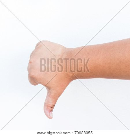 Child Hand Showing A Thumb Down Gesture. Isolated On White Background.