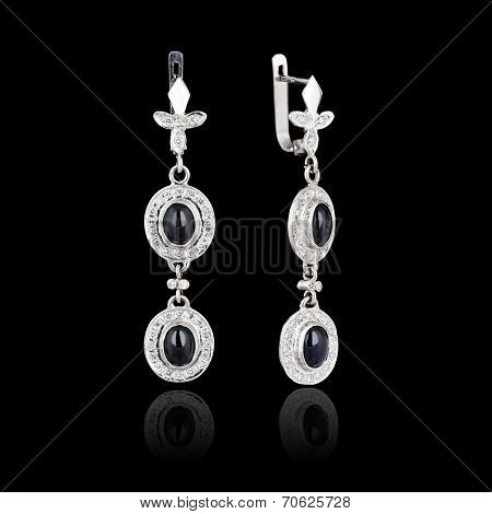 White Gold Earrings Isolated On Black Background