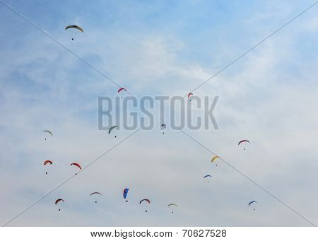 Paragliders flying in the sky