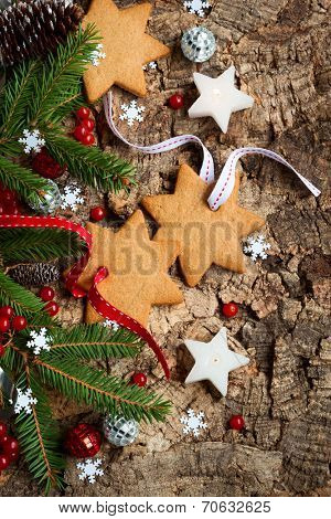 Christmas decirations and cookies on wooden background