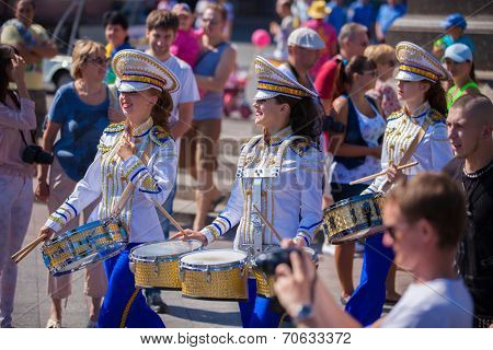 ODESSA, UKRAINE - August 23: Flash mob in city of Odessa on Potemkin Stairs on August 23, 2014, in day of a national flag of Ukraine. Happy drummers of summer Flash mob