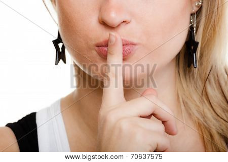 Closeup Of Girl With Finger On Lips Asking For Silence