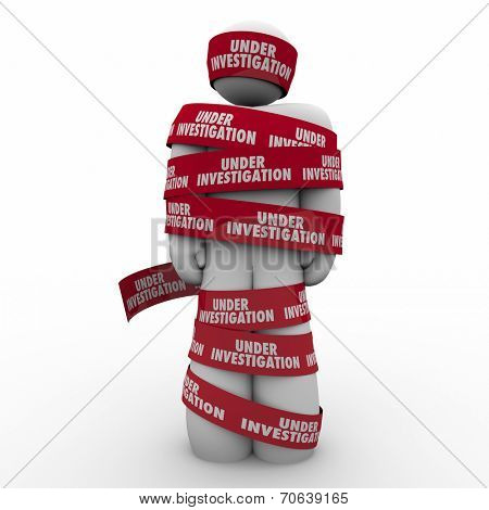 Under Investigation words on red tape wrapped around a man or person suspected of a crime and detained for questioning