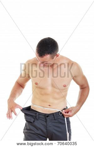 Man With Measuring Tape Around His Waist With Evidence Of Weight Loss