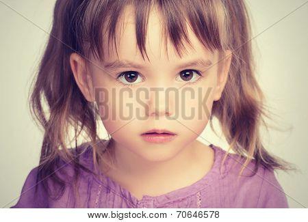 Little Beautiful Girl With Sad Eyes