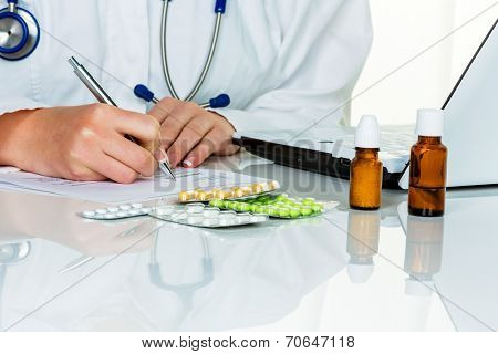a young doctor prescribes medication. prescription pills are prescribed by the doctor.