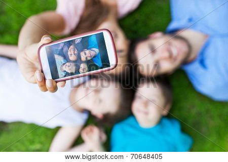 Family taking picture of themselves with smartphone